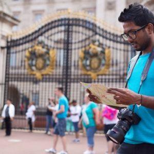 ndian visitor outside Buckingham Palace