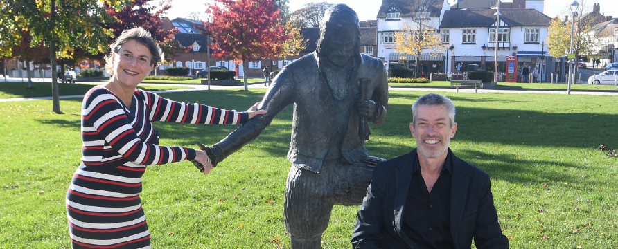 Helen Peters and Cllr Matt Jennings next to the 'Young Will' statue in Bancroft Gardens
